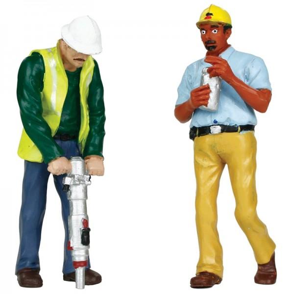 Gleisbauarbeiter mit schwerem Gerät